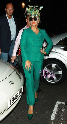 Literally!  Lady GaGa enjoyed a late night shopping sesh in Notting Hill on Wednesday.  The superstar dropped by Rellik wearing an emerald green suit with matching shoes and a dollar sign fascinator....