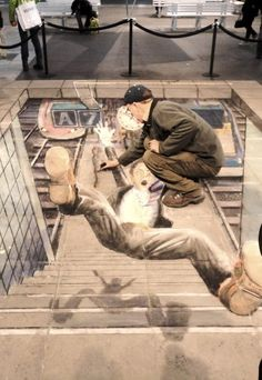 3D Street Art. I love how detailed and (almost) convincing this piece is. The intricate details, right down to the character's shadow, just add to the effects and the story of what happened to this man. The element of making him look animated contrasts the realistic-looking background. Amazing work