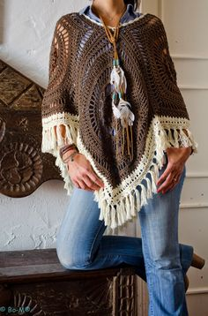Bo-M--inspiration only--beautiful ponchos and kimonos on this page--crochet. No patterns, but an experienced crocheter could suss out the granny square ponchos pretty easily I think.