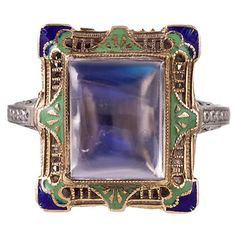 Blue Flash Moonstone & Enamel Filigree Ring | From a unique collection of vintage cocktail rings at https://www.1stdibs.com/jewelry/rings/cocktail-rings/