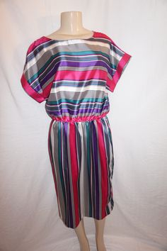 """Up for sale is a lovely Vintage Joan Curtis White Colorful Dress Size XL. The material is polyester and it does not have shoulder pads. The measurements are pit to pit 21"""", and the overall length is 44"""" long.             *PLEASE READ Below*  *Tag size on vintage clothing doesn't match current clo..."""
