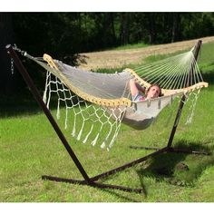 Sunnydaze Thick Cord Mayan Hammock with Curved Spreader Bars and Stand Combo.  Create an outdoor oasis when you add  a place for rest and relaxation. Featuring a unique design, this hammock's curved spreader bars is sure to take your outdoor comfort to the next level. #mayanhammock #hammock