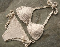 Set of boho crochet bikini and bottom embellished with shells . Crochet swimsuit made of high quality yarn.  Retro, boho chic style. Sure to be a favorite on the beach or at the pool. The bra cups are well shaped and adjustable due to the cords to bind, so you can adjust it how you need. The bottom is low, Brazilian bikini.  Fully lined with stretch-grid fabric, very soft and tender to skin.  You can choose from 3 sizes - S, M and L. Cup sizes from A to C are available. Keep in mind that…