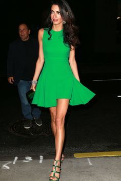 A bright hue like kelly green worn here by Amal Clooney works when paired with a minimal makeup look.