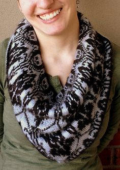 Free Knitting Pattern for High Functioning Cowl - This cowl inspired by the BBC Sherlock series features a skull motif and the Baker Street wallpaper design. Designed by Professor Fonz. Pictued project by stephisanerd