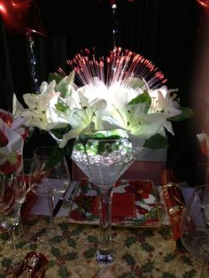 The centrepiece for our Christmas Day dinner table. A large martini glass/vase filled with water beads and silk flowers then a Sparkle Lites Fireworks was added.
