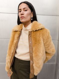 From fan favorite Maryam Nassir Zadeh, comes a bomber jacket you'll never want to take off. In brandy faux fur with leather trims, this jacket will add a touch of glam to any outfit.