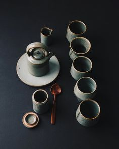 Dark green pots, all reduction fired with a high iron stoneware clay body. Spoon by JoJo Wood. High Iron, Wooden Spoons, Stoneware Clay, Ceramic Pottery, Tea Set, Old And New, Pots, Artisan, Ceramics