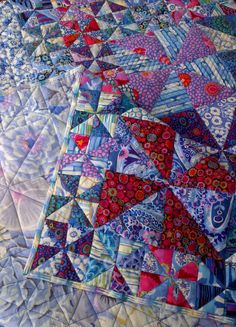 I finished quilting and binding my water-liliespinwheel quilt this week! It took almost 2 years for me to finish this quilt. I hand-...