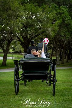 The married couple ride off in the Grand Oaks Victorian era carriage!! #wedding #antique #carriage #kisses #Florida #GrandOaksResort