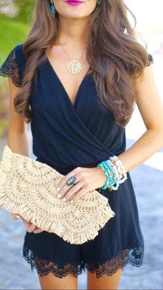 Black lace romper with clutch and accessories. | Date Night Style