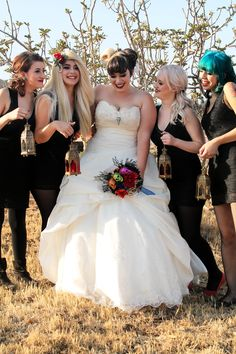We love bridesmaids in black, skull details, and an October wedding via @Jessica Massoth Bride