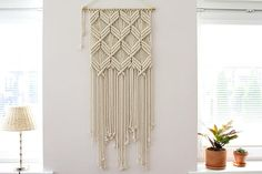 This large macrame wall hanging is made with natural cotton twisted rope. This is perfectly fit in the interior of living room, bedroom, kids room and even a cozy café or a studio. Designed with simple laconic geometric forms this macramé piece will look great in different modern interior's