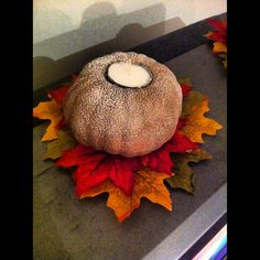 Dollar Tree Craft: foam pumpkin, spray paint, glitter spray, tea candle, leaves - cut a whole in the top to set the candle in and voila!