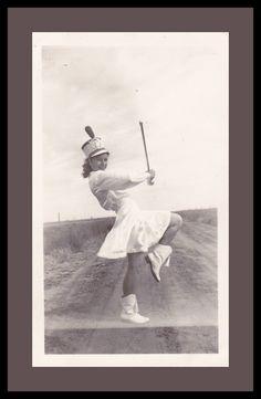 Baton Twirler- Marching Band Uniform- Practice Makes Perfect- SET of 2- 1940s Vintage Photograph. $9.50 USD, via Etsy.
