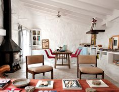Designer Ursula Mascaró creates an exotic, un-precious home with neutral furniture and artful objects in Menorca, Spain.