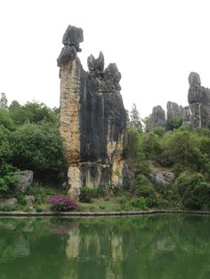 The limestone pinnacles in the Stone Forest at Shilin near Kunming, Yunnan, China, can be up to 30 meters high. This pinnacle is said to be a petrified Sani girl named Ashima who watches for her lover Ahei. Kunming, Tower Bridge, Mount Rushmore, Mountains, Watches, World, Travel, Turismo, China