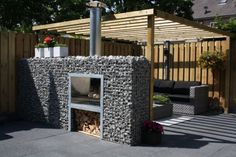 Gabion wall outdoor fireplace/bbq Tuinhaard met BBQ