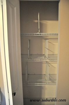 this hack will keep your linen closet organized for good, closet, shelving ideas, Using the lip of the shelf as the base of the shelf divider zap strap the base onto the wire shelves Strap them tightly and then trim the excess