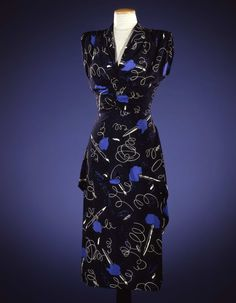 Dress in printed silk with motifs of white fountain pens and blue ink spots on black background;Elsa Schiaparelli (1890-1973), Paris (?); 1946 Compare with mama's