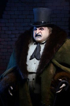 NECA is proud to present this scale rendition of the Penguin, featuring the likeness of actor Danny DeVito as he appeared in the 1992 Batman Returns movie. The fully poseable figure stands tall and features synthetic hair and a movie-authentic. Danny Devito Penguin, Batman Returns Penguin, Movies Costumes, Penguin Costume, Penguin Pictures, Joker Costume, Halloween Costumes, Batman Collectibles, Movie Crafts