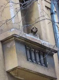 Balcony Statue in Budapest, Hungary. One of the many statues scattered throughout Budapest. (V)