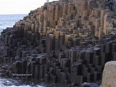 The Giant's Causeway lies at the foot of the basalt cliffs along the sea coast on the edge of the Antrim plateau in Northern Ireland. It is made up of some 40,000 massive black basalt columns sticking out of the sea. The dramatic sight has inspired legends of giants striding over the sea to Scotland.