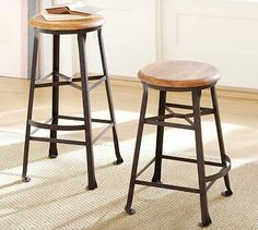 """Decker Barstool #potterybarn: Decker Barstool; $159.00; Vintage draftsman's stool; blackened base crafted from steel, with a curved footrest and rolled feet.Medium: 15.5"""" square, 24"""" high;; Seat hand stained in Rustic Pine; legs hand stained in Gun Metal."""