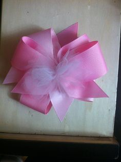 This was super easy to make. Two shades of pink grosgrain ribbon and little light pink tulle for the middle!!