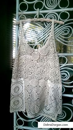 This lacy top has a mesh top part with vintage doilies and buttons. Great for layering over a bandeau or plain vest, dress etc. Suits sizes small to medium+ Please use the following measurements for a better guide:  Bust: 34 stretching to 40 Waist: 35 stretching to 40 Hips: 40 stretching to 46 Length approx. 26 to 29  Overpaid shipping is refunded. Thank you :-)  Lacy Top, Vest, Vintage Doily, Lace, Cream, White, Vintage Buttons, Boho, Rustic, Romantic Clothing