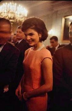 March 1961: Jacqueline Kennedy greets members of the 86th Congress in the State Dining Room at the White House