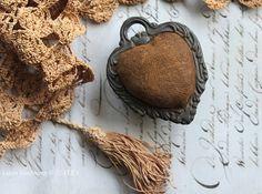antique heart pincushion