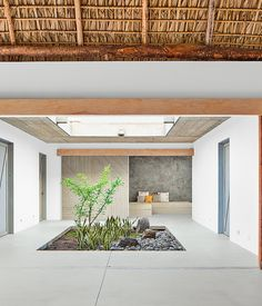 "Architect José Roberto Paredes calls the sliding walls utilitarian artwork. ""The doors open to a surprise space, like a secret pathway,"" ..."