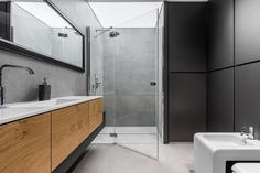 Home renovations are a great way to add value to your property and bring you one step closer to having your dream home. One common space that usually needs an upgrade is the bathroom! Pedestal Tub, Black Toilet, Black Backsplash, Bidet, Wall Mounted Lamps, Glass Countertops, Beige Marble, Shower Fixtures, Black And White Wallpaper