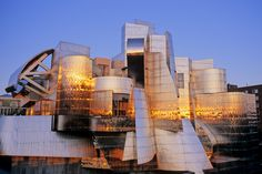 """Representing Frank Gehry's first museum built from the ground-up, the Weisman Art Museum is located on the banks of the Mississippi River on the University of Minnesota's Twin Cities campus. Affectionately known as the """"Baby Bilbao,"""" a reference to the later Guggenheim's iconic museum in Spain, the Weisman's organic curves of stainless steel were designed without the aid of computer software, predating a process Gehry would later innovate through his use of CATIA modeling software."""