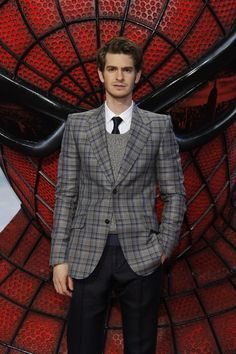 Andrew Garfield in a Gucci grey and blue checked Marseille jacket: www.gucci.com