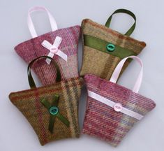 Cute little tweed handbag shapes filled with aromatic French dried lavender. These bags measure approximately 10cm x 8cm (4 x 3) not including the ribbon handle. They are machine sewn at the side seams and hand sewn closed once filled. Choose a ribbon stripe and button detail or a ribbon bow and button. A lovely little gift or wedding favour. Choose from 4 gorgeous colours of lovely soft tweed, green, blue, lilac and pink. Lavender scent will last for many years and just give it a squeeze…