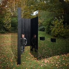 Scott Kyson combines charred timber with smoked glass for garden pavilion