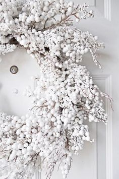 The French Bedroom Company | Get Guest Ready for Christmas over on the blog. Top Tips on organising your home for the festive season - not just christmas decorations, but thinking of chairs, spare bedroom ideas and inspiration for visiting pets. White christmas door wreath with white front door