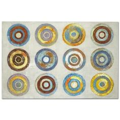On Target. The large scale and mix of colors found in the Color Wheels canvas print qualify it as a terrific focal piece. Its particular hand-painted style evokes both rustic and contemporary qualities.