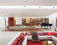 The custom-made sofa in the open-plan living area, with its brass back detail, was originally going to be an Eames Compact couch. But when its exposed back was deemed visually objectionable, Girard modified the piece to suit the room.