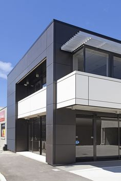 Foley Architects Building, Christchurch, New Zealand. Black cladding in Laminam Filo Pece 1000x3000 mm, mounted on facade system. White Balcony in Laminam Collection Bianco 1000x3000 mm. Laminam' slabs improve the building value giving it a unique and modern look.