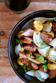 Sausage, Onions & Taters: Slice up 1 pkg. Hillshire Farms beef smoked sausage & chop 3/4 white onion and fry both on stovetop until browned to your liking. Chop 4-5 red taters (leave skin on) into cubes, cover in olive oil, garlic salt & onion powder and bake at 425 for 20 min (toss) then bake another 15 min until browned to your liking. Toss all ingredients together & serve!