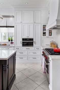 white kitchen cabinetry with built-in microwave and gas stove Jane Lockhart Interior Design