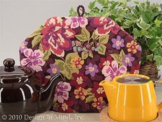 Tea Cozy - Floral Chic|Standard . $31.95. A modern floral tea cozy in raspberry, dark lilac, deep mauve and plum with two-toned green leaves on a brown quilters cotton. Shown with a brown Chatsford teapot and a mandarin ForLife stump teapot.