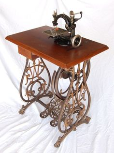Gorgeous Small Wilcox Gibbs treadle sewing machine. Notice the very fancy cast iron base and foot pedals.
