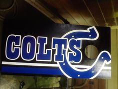 Colts Cornhole Board -- Black Boards with Colts Name, Horseshoe and Underlines.  The vinyl can be purchased at Crafty Treasures on FB.