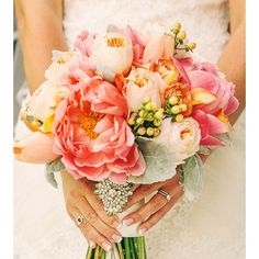 We're in love with the bold blooms in this beautiful bouquet! Sunsets and romance are what come to mind. Xoxo @weddingchicks #bouquet #wedding #peony #pink #instatakeover