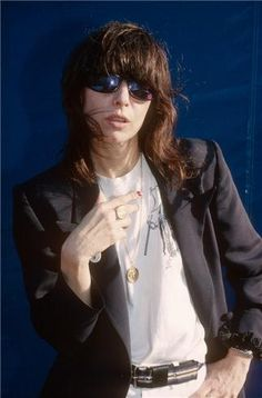 American singer-songwriter and musician. She is the founding and sole constant member of the rock band The Pretenders. Chrissie Hynde and The Pretenders were inducted into the Rock and Roll Hall of Fame in Outfit Essentials, Chrissie Hynde, Cute Work Outfits, The Pretenders, Medium Long Hair, The Clash, Professional Outfits, Trends, Outfit Combinations