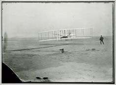 December 17, 1903: Orville Wright pilots the Wright Flyer in the first successful flight of a powered heavier-than-air flying machine at Kitty Hawk, NC. This first flight lasted 12 seconds and covered 36 m (120 ft).  Wilbur Wright is pictured at right.